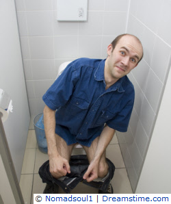 Man using public toilet seat
