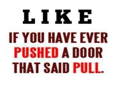 Pushing a door that says pull
