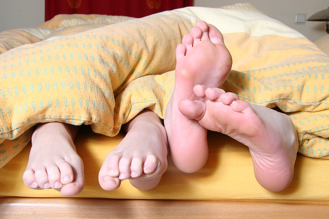 Feet poking out of bottom of bed